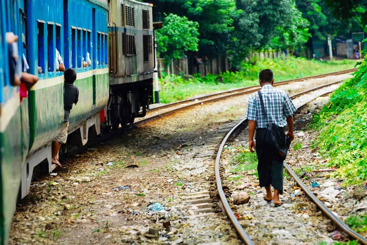 myanmar yangon circular line man walk railway
